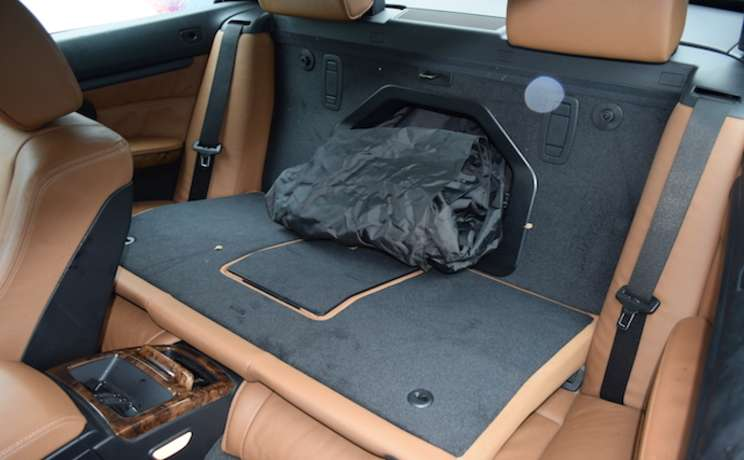 Bmw e93 3 series rear seat down and wind deflector thur the passageway